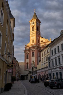 Low angle view of St. Paul Church against cloudy sky in Passau at sunset, Bavaria, Germany - ELF02054