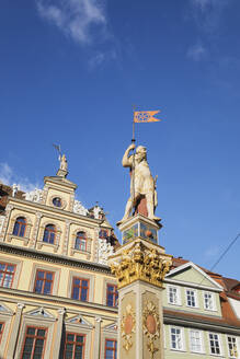 Low angle view of Roland Statue and Renaissance building against blue sky in Erfurt, Germany - GWF06191