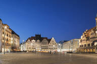 Town square amidst buildings against clear blue sky at night in Saxony, Germany - GWF06204