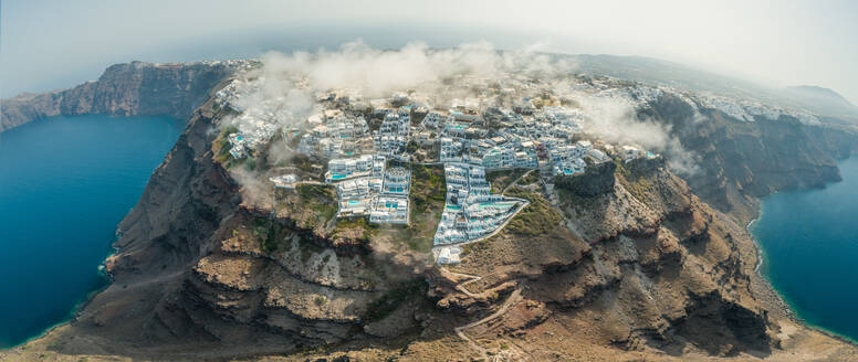 Panoramic aerial view over the clouds and bay of Santorini island, Greece - AAEF00140