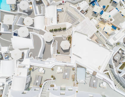 Aerial view above traditional white houses on Santorini island, Greece - AAEF00146