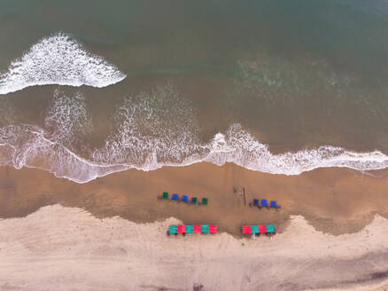 Top down aerial view of waves on mandrem beach in Goa state of India - AAEF00308