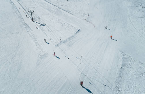 Aerial view of people on ski lift at skiing resort at Mount Erymanthos in Greece - AAEF00587