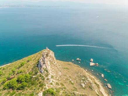 Aerial panoramic view of coastline, speed boat and rocks, Cagliari, Sardinia. - AAEF00755