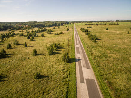 Aerial view of straight road in the countryside in Estonia. - AAEF00926