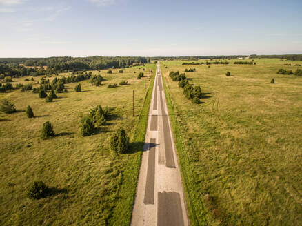 Aerial view of straight road in the countryside in Estonia. - AAEF01004
