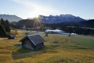 Log cabins against Geroldsee Lake and Karwendel mountains in Bavaria, Germany - RUEF02301