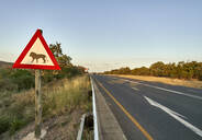 Beware of lions sign at the roadside, Marloth Park, South Africa - VEGF00471