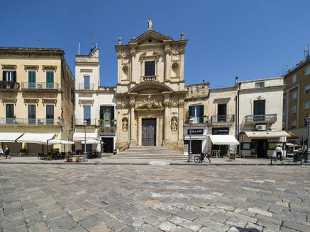 View of old church and buildings against clear blue sky in Altstadt, Lecce, Italy - AMF07256