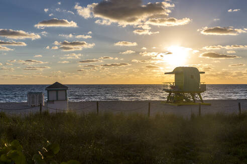 Beach hut at sea shore of Miami Beach against sky during sunrise, Florida, USA - MABF00545