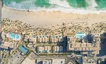 Aerial view of resort and beach on Pearl Jumeirah island in Dubai, UAE - AAEF01075