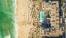 Aerial view of resort and beach on Pearl Jumeirah island in Dubai, UAE - AAEF01078