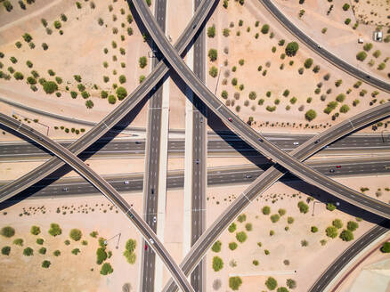 Aerial view of multi-lane road intersection on desert landscape, Las Vegas, USA - AAEF01312