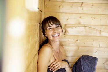 Portrait of happy woman in a sauna - FMKF05869