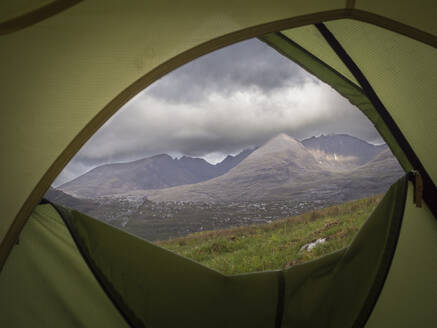 Scenic view of mountains against cloudy sky seen through tent, Scotland, UK - HUSF00071