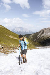 Boy hiking in the mountains - FKF03540