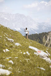 Boy hiking in the mountains - FKF03546