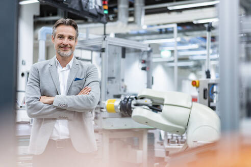 Portrait of a confident businessman in a modern factory - DIGF07842