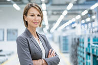 Portrait of a confident businesswoman in a modern factory - DIGF07872
