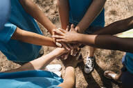 Group of kids stacking hands - JCMF00122