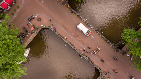 Aerial view of people cycling in Amsterdam city center, The Netherlands - AAEF01658