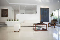 Coffee table, chairs and walls in modern living space - BLEF13933
