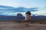 Trash can on stilts in desert, Monument Valley, Utah, United States - BLEF14119