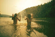 Children splashing in lake - BLEF14125