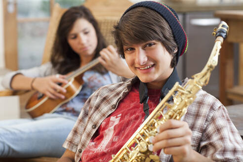 Mixed race teenagers playing musical instruments - BLEF14176