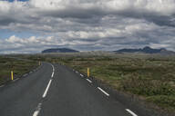 Empty road through landscape in Iceland - UUF18656