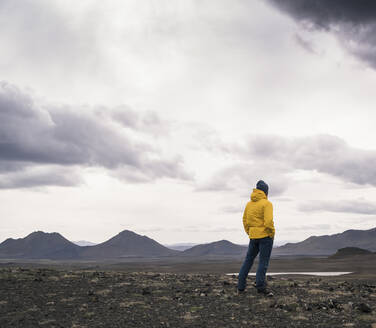 Mature man looking at view, Highland region, Iceland - UUF18764