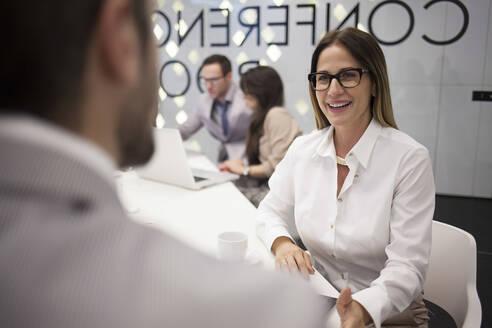 Caucasian business people talking in office meeting - BLEF14508