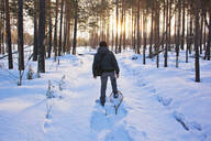 Mari man snowshoeing on snowy path - BLEF14532