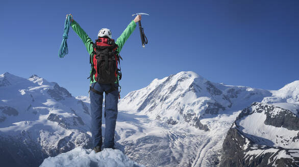 Caucasian hiker cheering on mountaintop, Monte Rosa, Alps, Italy - BLEF14541