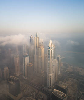 Aerial view of skyscrapers touching the clouds in Dubai, United Arab Emirates. - AAEF01755
