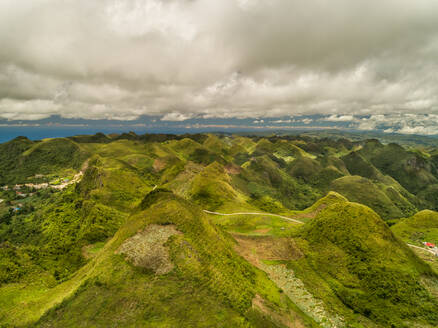 Aerial view of Chocolate hills and cloudy sky in Badian, Philippines. - AAEF01803