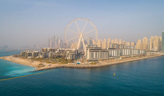 Aerial view of the Ferris wheel under construction on Bluewaters island in Dubai. - AAEF01839