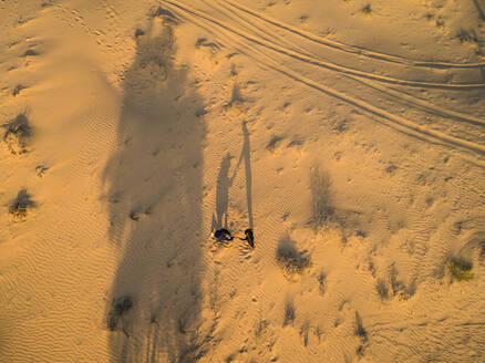 Aerial creative view of a marriage proposal in the middle of the desert in Dubai, U.A.E. - AAEF01947