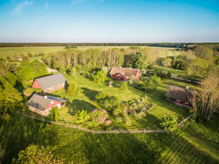 Aerial view of few houses in countryside of Estonia - AAEF01993