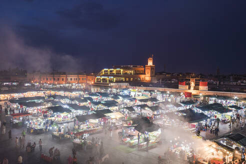 Jemaa el-Fnaa at sunset, bustling market square, UNESCO World Heritage Site, Marrakesh, Morocco, North Africa, Africa - RHPLF00351