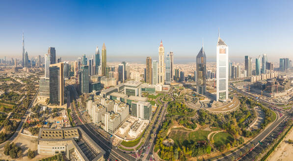 Aerial panoramic view of Dubai cityscape, Emirate Towers and skyscrapers, UAE. - AAEF02323