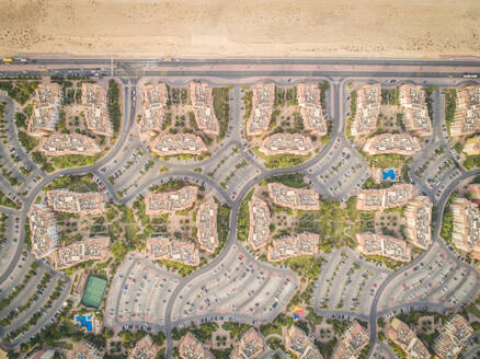Aerial view of abstract, geometrical Discovery Gardens urban area, Dubai, UAE. - AAEF02329