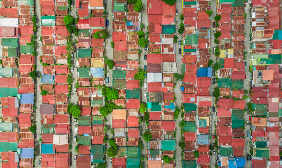 Aerial view of colourful roofs of residential district, Imus, Philippines. - AAEF02434