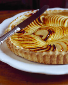 Apple pie in white plate on table - PPXF00223
