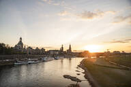 Augustus Bridge over Elbe river against sky in city during sunset, Saxony, Germany - CHPF00559