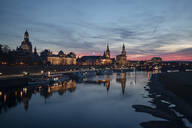 Boats moored on Elbe river against sky in city at dusk, Saxony, Germany - CHPF00562