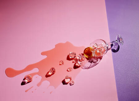 High angle view of drink fallen on colored background - KSWF02041