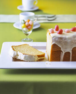 Lemon cake with Easter decoration on table - PPXF00242