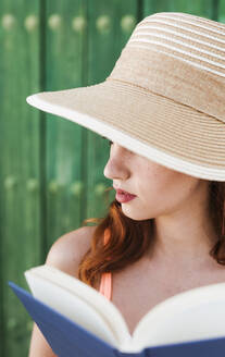 Young woman with book in summer - LJF00674