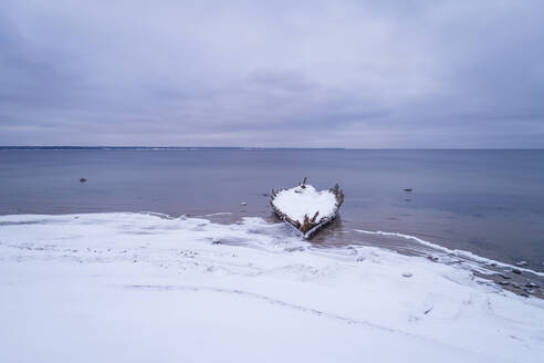 Aerial view of a wooden shipwreck on the beach of Kasispea in Estonia - AAEF02460